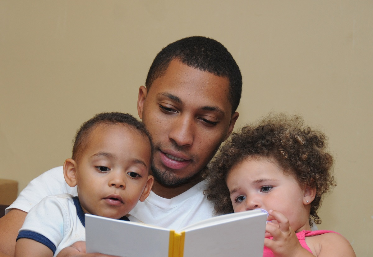 Father reading to his two children