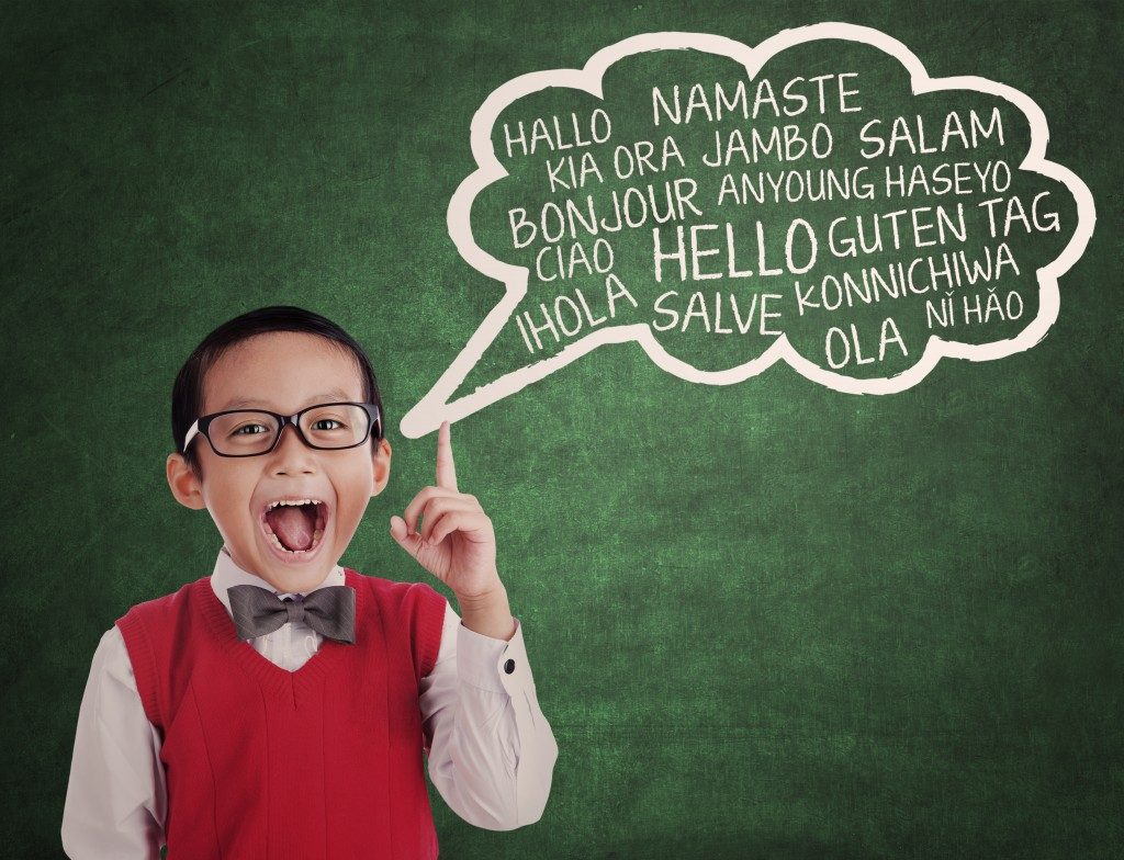 boy learns to speak different languages