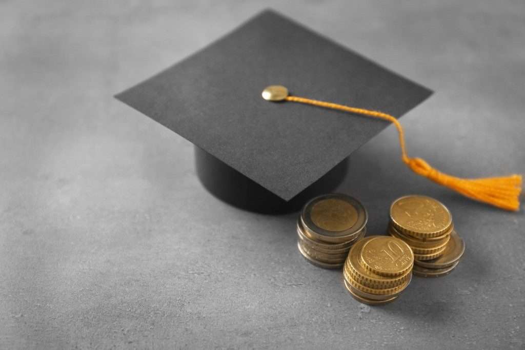 Graduation hat and coins on table