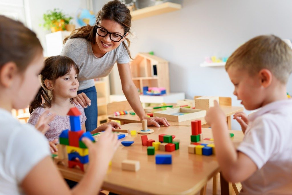 Teacher looking after kids