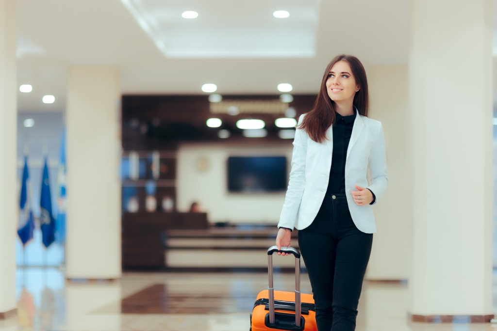 woman walking around with her luggage