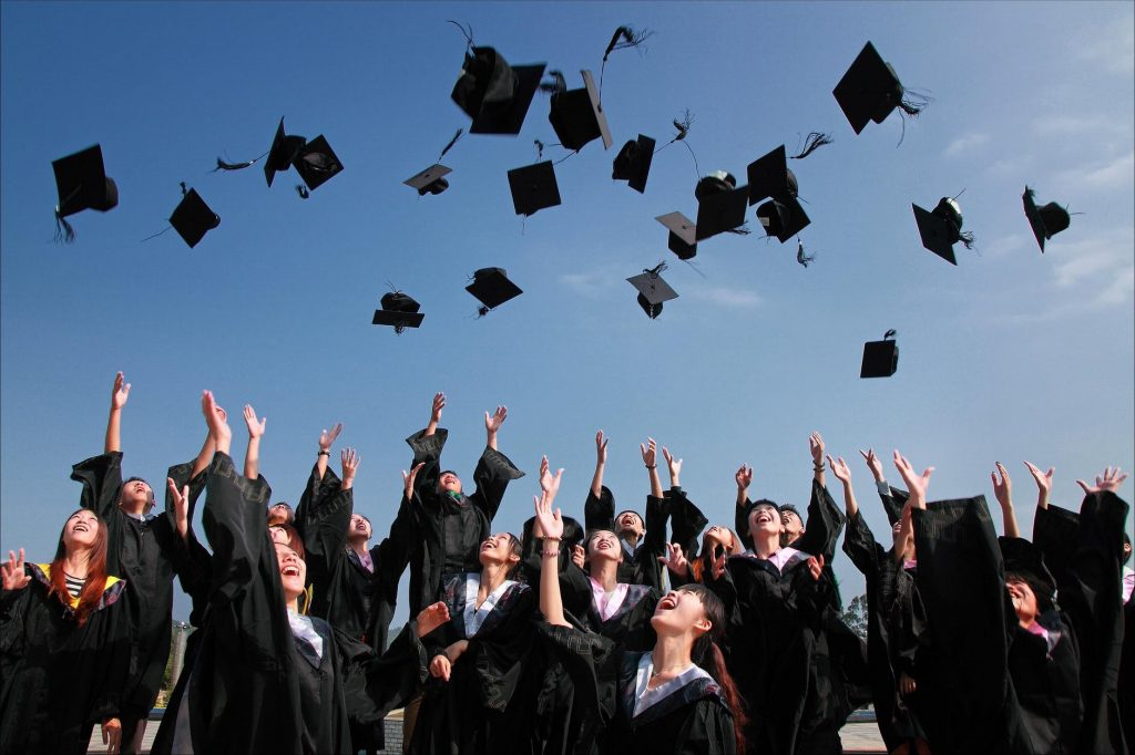 Graduates throwing their caps