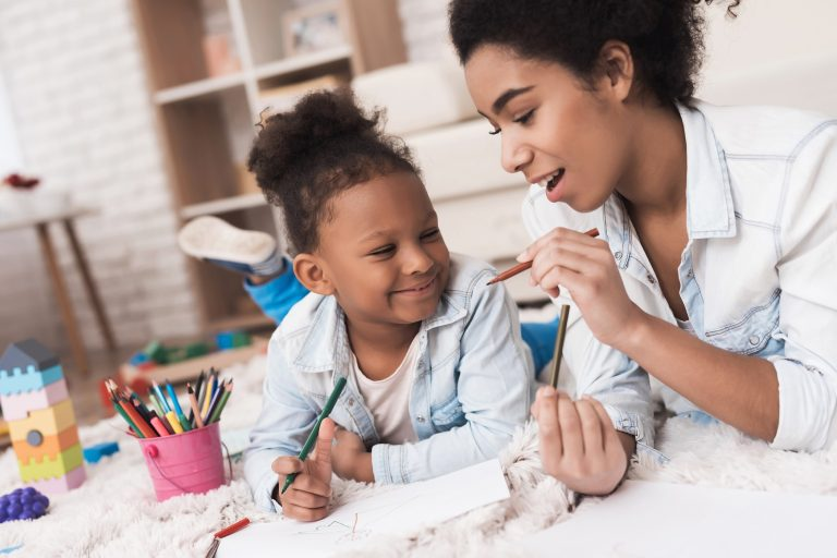 mother teaching kid to be crative