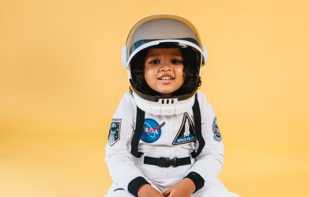 child in astronaut costume